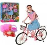 Кукла на велосипеде .
